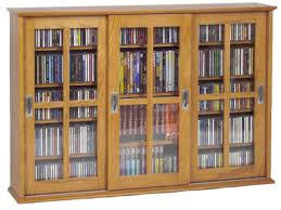 Cd And Dvd Storage Cabinet With Doors Oak Finish Glass Door Dvd Cd Cabinets Dvd Cd Storage Com