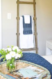5 super simple tips for guest room readiness zdesign at home simple guest room tips aqua navy bedroom kravet riad navy pillows and curtains 6