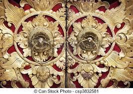 wood carving door ornate entrance door to temple in bali stock