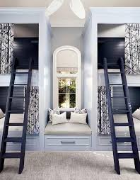 light blue built in bunk beds with navy blue shiplap trim