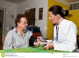 Home Nurse by Nurse Looks Old Woman In A Nursing Home Royalty Free Stock Photos