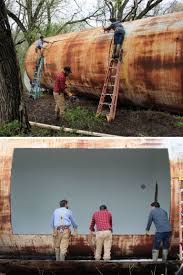 rusty storage tank converted into a luxurious tiny house