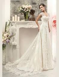 tissus robe de mariã e tissu dentelle mousseline de soie ivoire avec paillettes or et