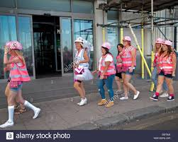 themed clothes a hen party themed around the clothes of builders walks along a