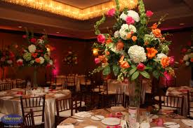 eventful disclosure tall pink and orange floral wedding centerpieces