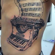 grey ink music piano typewriter tattoo on side rib tattooshunt com