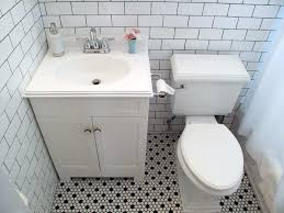 vintage black and white floor tile bathroom remodel inspiration white subway tiles