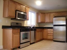 maple cabinets kitchen cabinets stainless steel appliances
