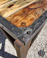 a new table made using an angle iron bed frame and reclaimed wood