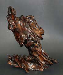 large wood sculpture an and large root wood sculpture item 1114815