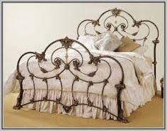 antique iron bed looks alot like mine that was my grandfathers