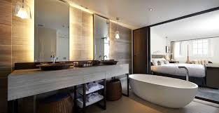 a hospitality bathroom design with a sliding door that leads to