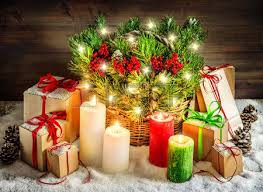 christmas branches with lights christmas decoration burning candles and gift boxes christmas
