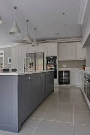love the kitchen island in the middle and the color tone grayish