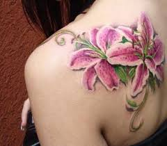 hawaiian and lily flower tattoos are becoming good choice of girls