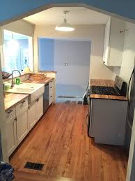 should kitchen cabinets match wood floors flooring to match or not to match