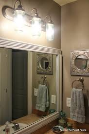 bathroom pine oval resin lights above mirror bohemian leaning