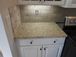 granite countertop refrigerator with cabinet panels clearance