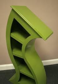 handmade curved wooden bookshelves the green head
