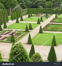 formal ornamental garden green plants geometrical stock photo