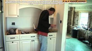 How To Level Kitchen Base Cabinets How To Install A Kitchen Island Youtube