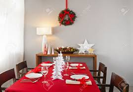 christmas dinner table setup with decoration on the side board