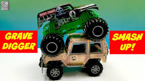 grave digger 30th anniversary monster truck toy grave digger smashes up a jeep monster jam freestyle youtube
