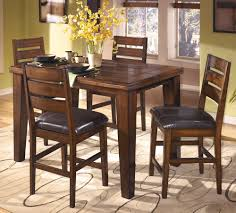 counter height dining set with butterfly leaf extension by ashley