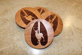 wooden deer coasters with buck engraved on maple or cherry wood