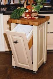diy pull out trash can in a kitchen cabinet concealing the