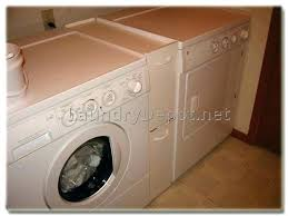 Laundry Room Storage Between Washer And Dryer Cabinet Around Washer And Dryer Laundry Washing Machine