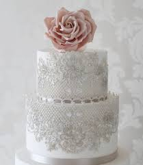 wedding cake lace silver dusted cake lace and pink sugar flower traditional wedding