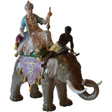 meissen porcelain figurine of man and blackamoor on elephant at