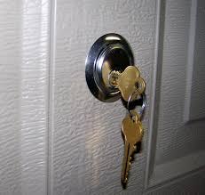 securing up and over garage door garage doors garage door locks and handles security locksets