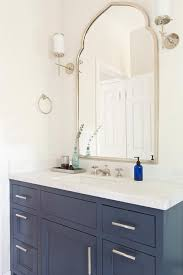 traditional bathroom mirror blue bath vanity with uttermost kenitra arch wall mirror regarding