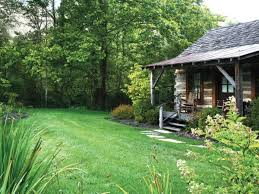 Evergreen Landscaping Ideas Artistic Log Cabin Landscaping Ideas Using Black Rock Edging