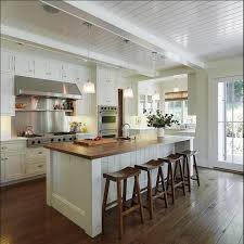 kitchen island with butcher block top white cabinets butcher block island saddle stools plank ceiling