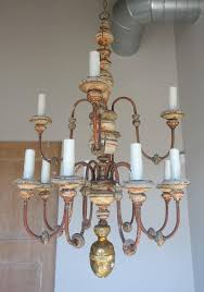 Painted Chandelier Twelve Light Italian Wood And Iron Painted Chandelier