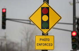 red light camera ticket settlement red light traffic camera firm will pay the city 20 million to