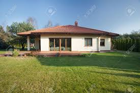 beautiful parter bungalow with big garden stock photo picture and