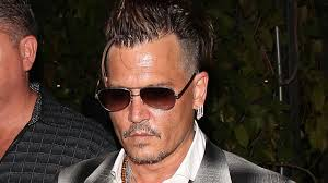 somber johnny depp attends late mother u0027s memorial with his