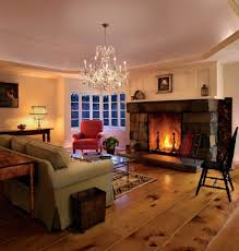 living room with fireplace and crystal chandelier cleaning tips