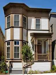 awesome victorian row house with two level bay windows using white