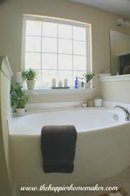 ideas for bathroom decor decorating around a bathtub the happier homemaker