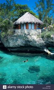 ecotourism thatched roof guest rooms on the edge of cliffs and the