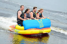 lake toys for adults how to choose the best towable tubes for boating west marine