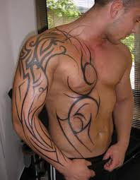 men chest and sleeve with rib side grey ink tribal tattoo