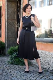 classic and elegant styling of a little black dress lady of style