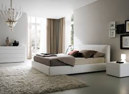 Bedroom Bed In Corner Bright Bedroom With Modern White Bed Set Also Awesome Chandelier
