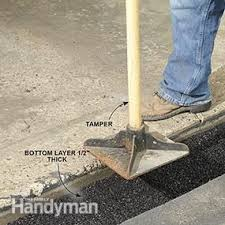 concrete driveway sinking repair how to fix a sinking driveway family handyman